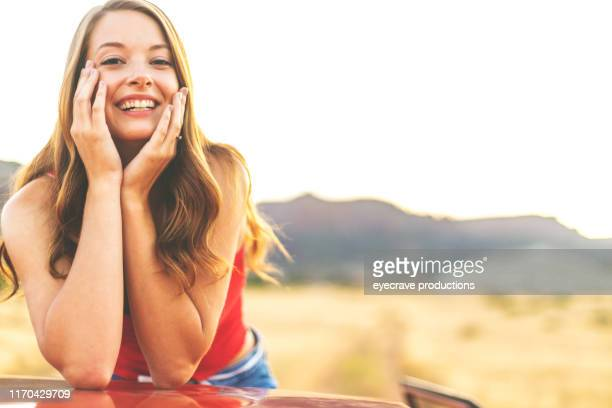 Generation Z Young Beautiful Female in non urban desert setting on dirt road in Western Colorado during the golden hour