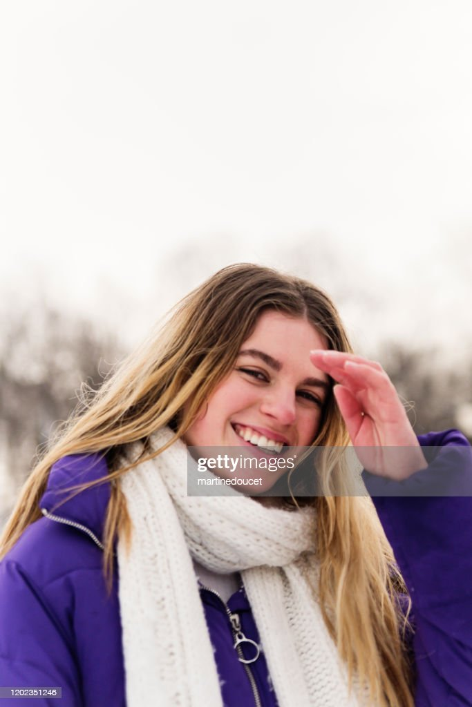 Generation Z young woman in snowy public park. : Stock Photo