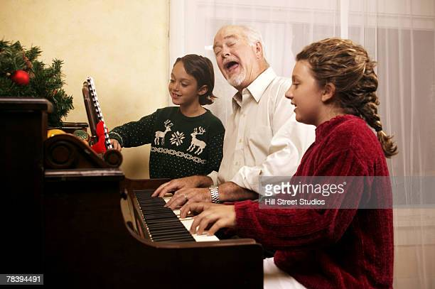Generational family playing piano during Christmas season