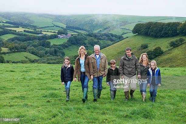 Generational family walking in fields