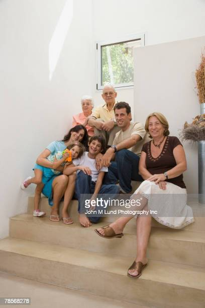 generational-generational hispanic family on stairs - zia e nipote foto e immagini stock