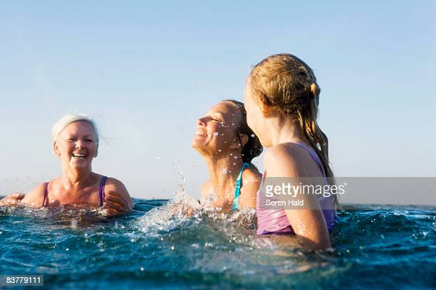 3 generations bathing - sea swimming stock photos and pictures