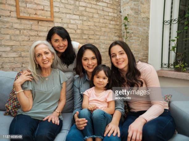 generations of women from the same mexican family - mexican mothers day stock photos and pictures