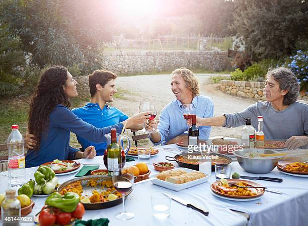 3 generations toasting at dinner party - klaus vedfelt mallorca stock pictures, royalty-free photos & images