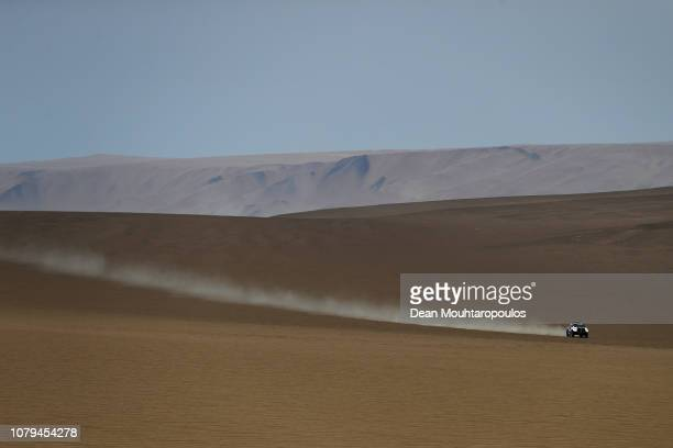 Energy Team no 311 TOYOTA HILUX car driven by Vladimir Vasilyev of Russia and Konstantin Zhiltsov of Russia compete in the desert during Stage Two of...