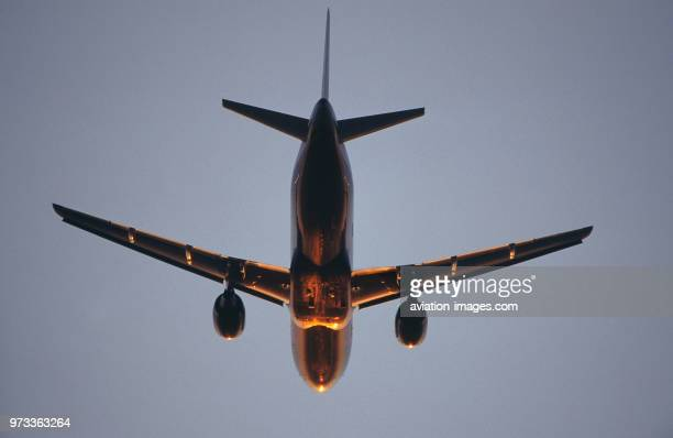 generic Airbus A320100 climbing enroute at dusk