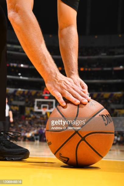 A generic basketball photo of a referee picking up the Official @NBA Spalding basketball during the Brooklyn Nets game against the Los Angeles Lakers...