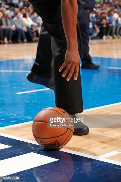 A generic basketball photo of a referee reaching down for the Official @NBA Spalding basketball during the Detroit Pistons game against the Dallas...