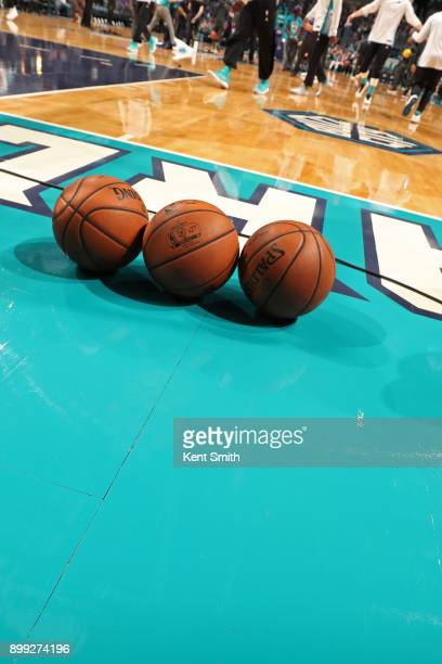A generic basketball photo of the Official @NBA Spalding basketballs on the court before the Milwaukee Bucks game against the Charlotte Hornets on...