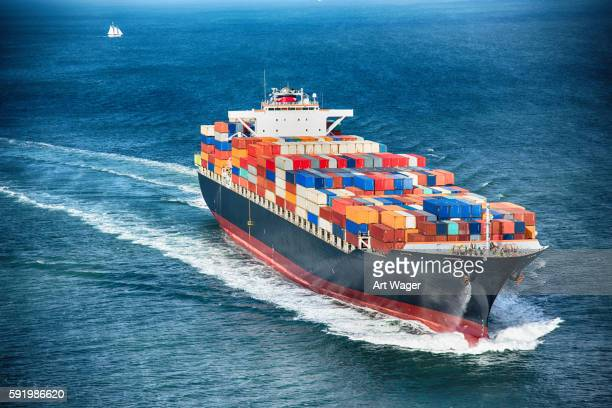 generic cargo container ship at sea - heavy industry stock photos and pictures