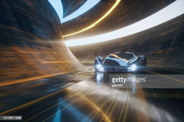 generic futuristic sports car speeding in the underground tunnel - man made structure stock pictures, royalty-free photos & images