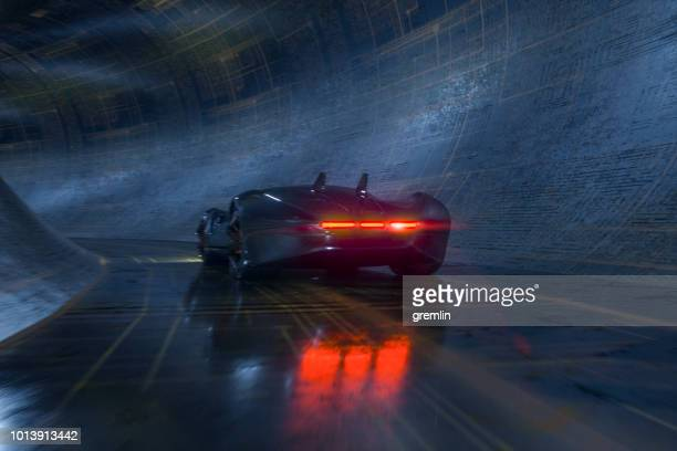 Generic futuristic sports car speeding in the underground tunnel
