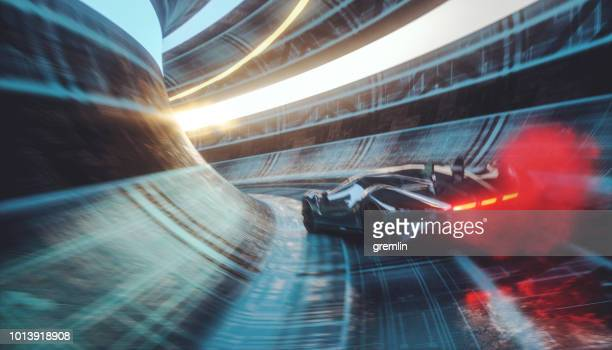 generic futuristic sports car speeding in the underground tunnel - motorsport stock pictures, royalty-free photos & images