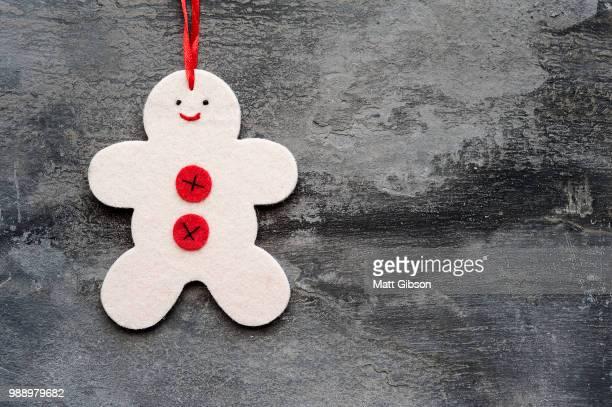 Generic machine made Christmas gingerbread man ornament on rusti