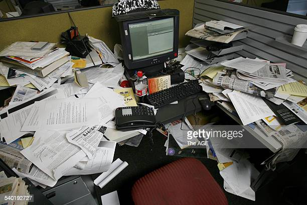 A generic messy desk THE AGE Photo by KEN IRWIN