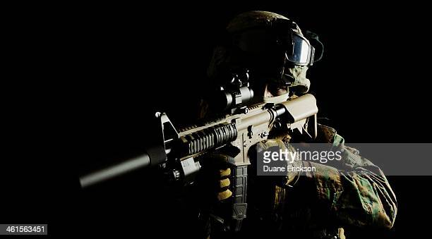 Generic photo of a Marine pointing an assault rifle