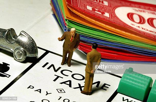 Generic photo of Monopoly board showing two businessmen standing on an 'Income Tax' square AFR Picture by JIM RICE