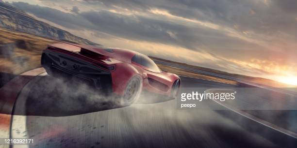 generic red sports car drifting around racetrack corner at speed - sports track stock pictures, royalty-free photos & images