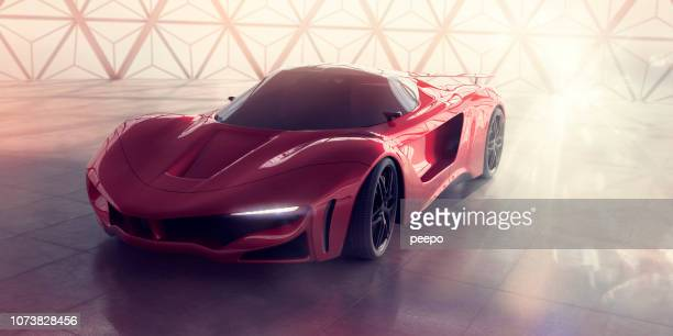 generic red sports car inside contemporary building with strong sunlight - sports car stock pictures, royalty-free photos & images