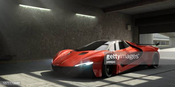 generic red sports car parked in empty garage - red stock pictures, royalty-free photos & images
