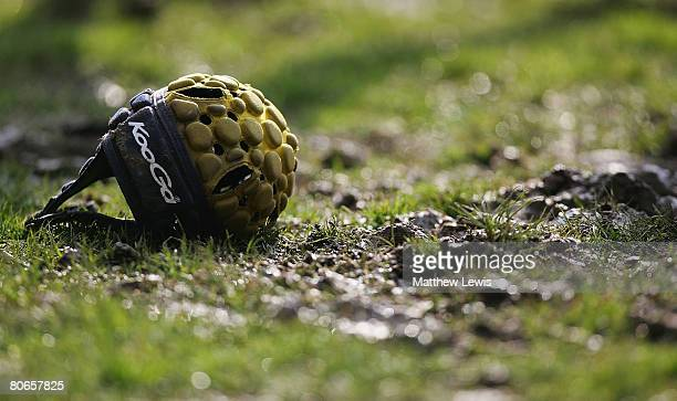 A generic scrum cap is left on the pitch during the Guinness Premiership match between Leeds Carnegie and Harlequins at Headingley Stadium on April...