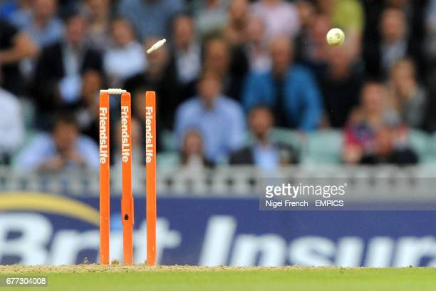 A generic view of a cricket ball dislodging a bail as a runout is attempted in the game between Surrey Lions and Kent Spitfires