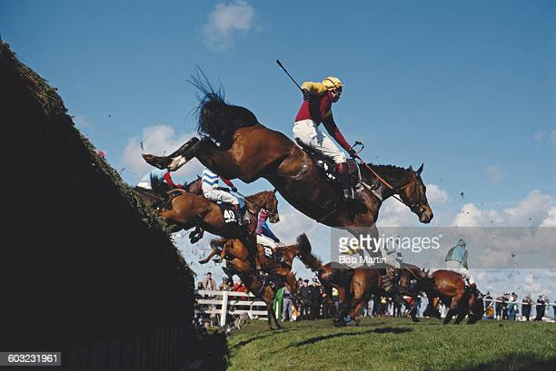 Generic view of horses and jockeys jumping Becher's Brook during the143rd running of the Seagram Grand National horse race on 8 April 1989 at the...