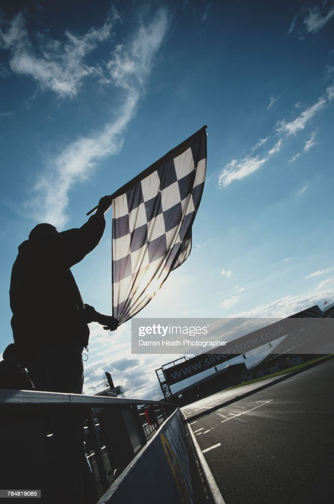 A generic view of the chequered flag as it is held over the start finish line of the track circuit on 13 August 2006 at the Silverstone Circuit in Towcester, Great Britain.