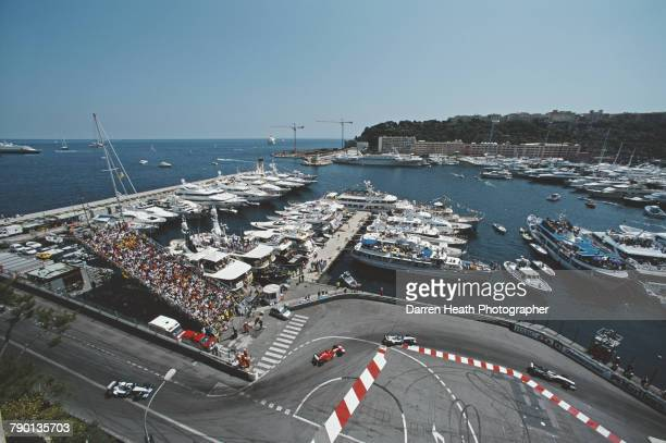 A generic view of the Nouvelle Chicane as the cars pass and the super yachts in the harbour during the Formula One Monaco Grand Prix on 26 May 2002...