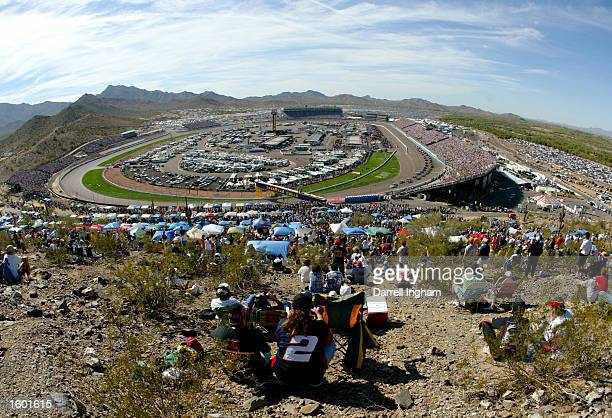 Generic view of the race start from the hills above the track at the NASCAR Winston Cup Series Checker Auto Parts 500 on November 10, 2002 at the...