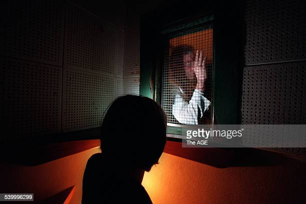 Generic woman inside a confessional box with a priest giving a blessing 19 December 2001 The AGE Picture by MICHAEL RAYNER