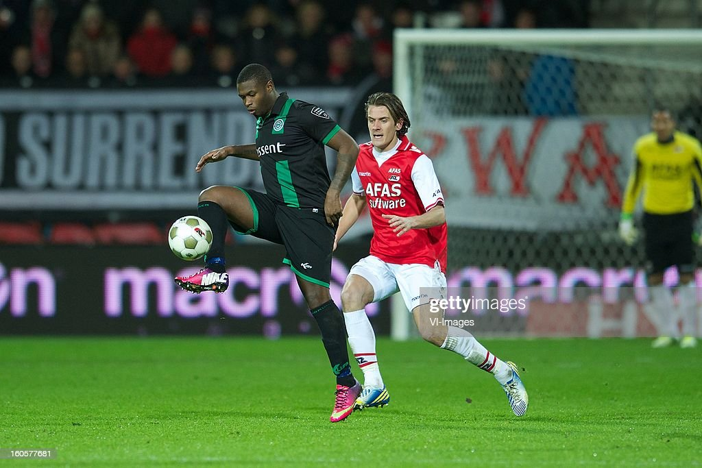 Genero Zeefuik of FC Groningen, Etienne Reijnen of AZ during the Dutch Eredivisie match between AZ Alkmaar and FC Groningen at the AFAS Stadium on february 2, 2013 in Alkmaar, The Netherlands