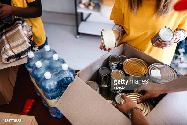 generous people helping to poor people - food and drink stock pictures, royalty-free photos & images