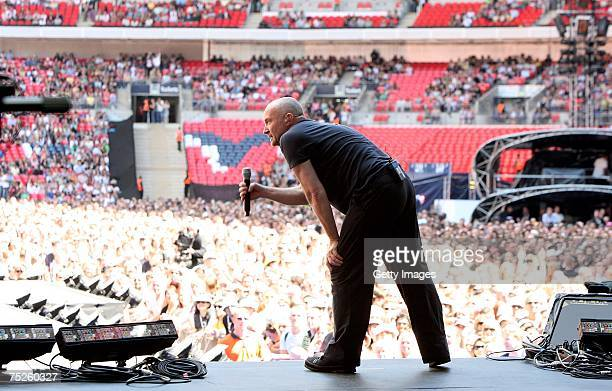 Genesis frontman Phil Collins performs on stage during the Live Earth concert at Wembley Stadium on July 7 2007 in London England Live Earth is a...