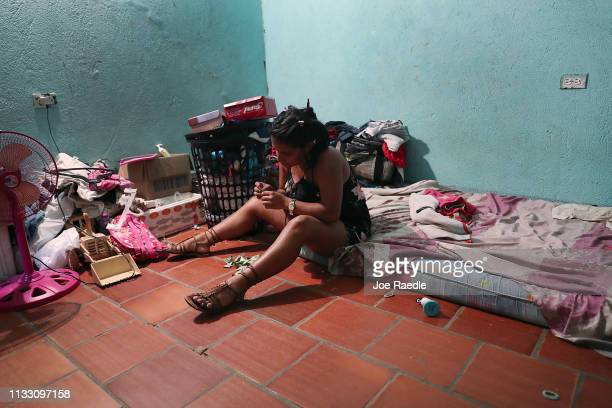 Genesis Rivas originally from Venezuela sits on her bed as she arrives home after a day of working as a street vendor on March 1 2019 in Cucuta...