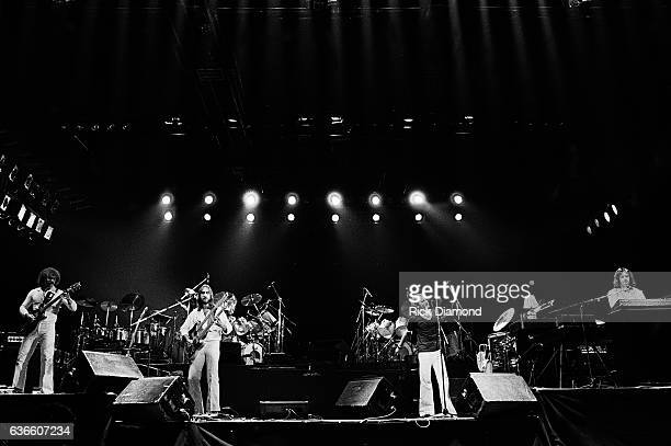 Genesis Rock and Roll Hall of Fame L/R Daryl Stuermen Mike Rutherfor Phil Collins and Tony Banks perform at The Omni Coliseum in Atlanta Georgia...