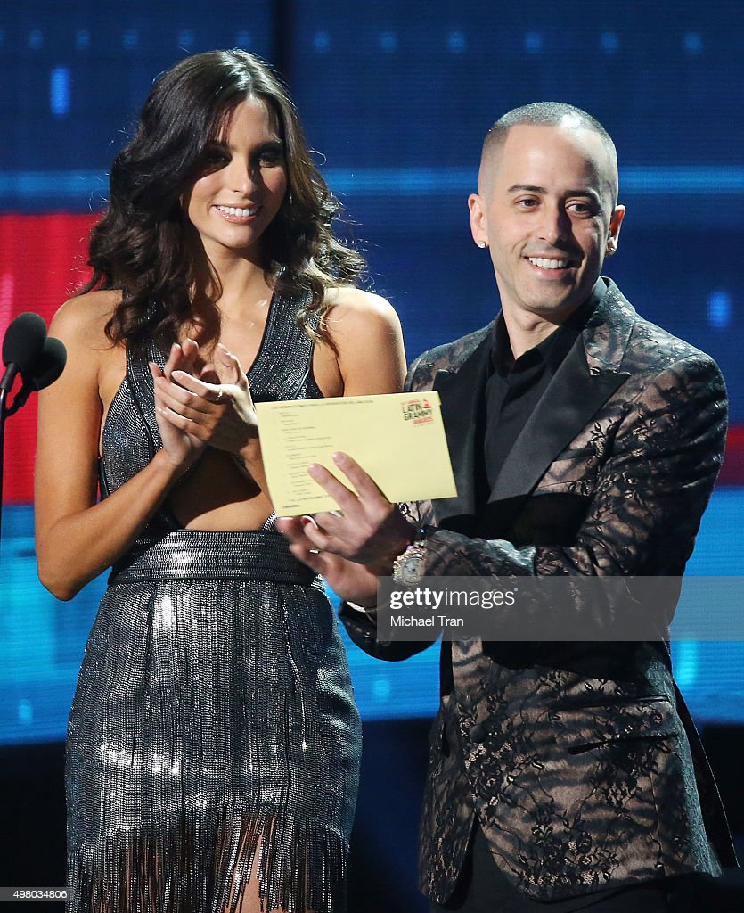 Genesis Rodriguez and recording artist Yandel speak onstage during the 16th Annual Latin GRAMMY Awards held at MGM Grand Garden Arena on November 19, 2015 in Las Vegas, Nevada.