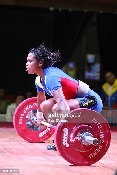 Genesis Rodriguez of Venezuela A competes in the Women's 53kg snatch during day two of the 2013 Junior Weightlifting World Championship at Maria...