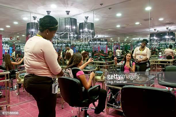 Genesis Ruiz of New York has her hair done by Felisha Alexander a staff member at Hair salon on Rewards Street inside Judge Rotenberg Center The...