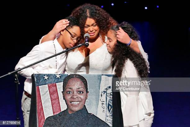 Genesis Villella, center, and twins Delilah and Peter Vega, children of New York City Police Officer Miosotis Familia, participate during her funeral...