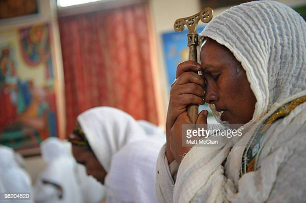 Genet Desta leans on a staff as she prays at the Ethiopian Orthodox Church April 1 2010 in Denver Colorado Members of the Ethiopian Orthodox Church...
