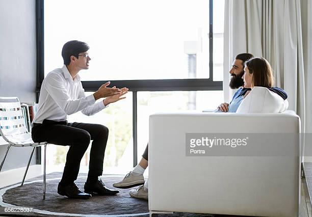 Genetic counseling advisor advising couple