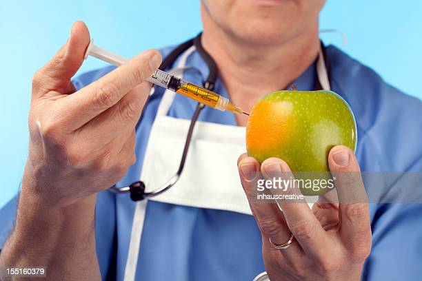 genetic manipulation of an apple - geneticist stock pictures, royalty-free photos & images