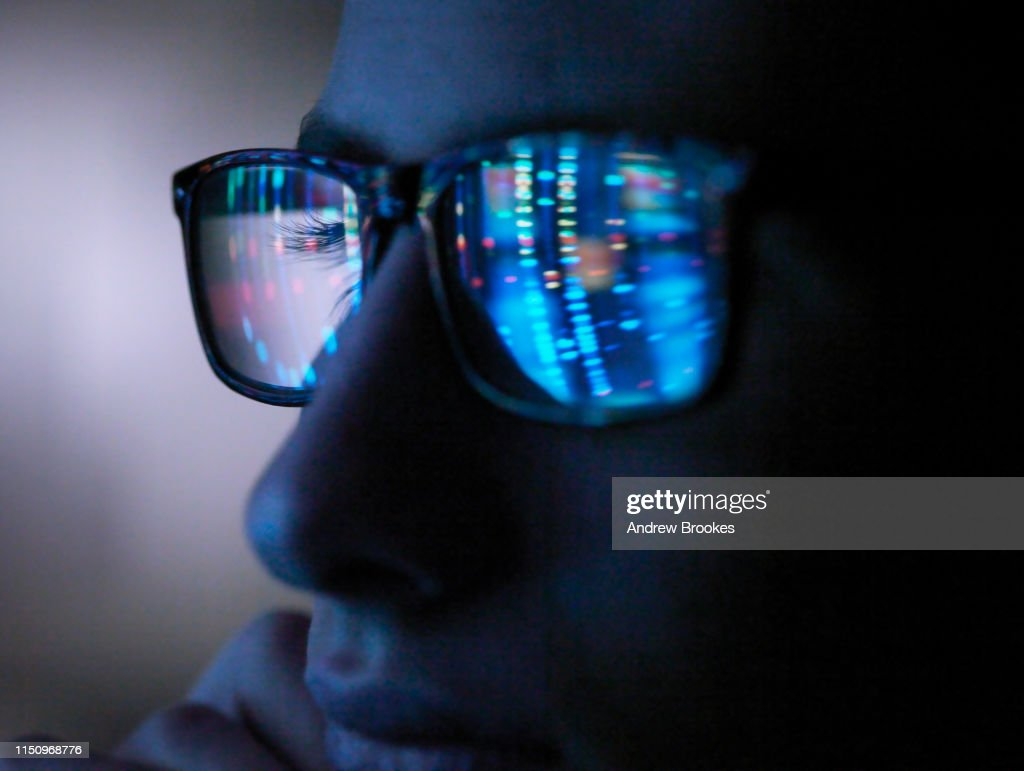 Genetic research, computer screen reflection in spectacles of DNA profile, close up of face : Stock Photo