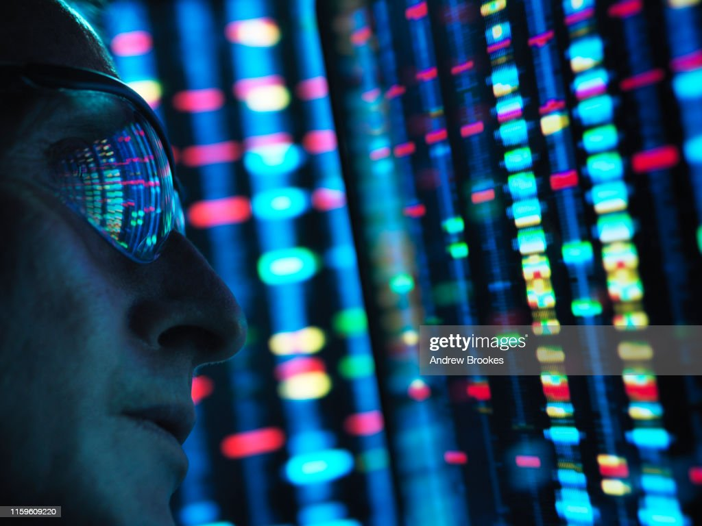 Genetic Research, scientist viewing DNA information on screens, close up : Stock Photo