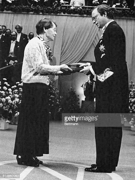 Genetic researcher Barbara McClintock receives the 1983 Nobel Prize for Medicine from King Carl Gustaf of Sweden.