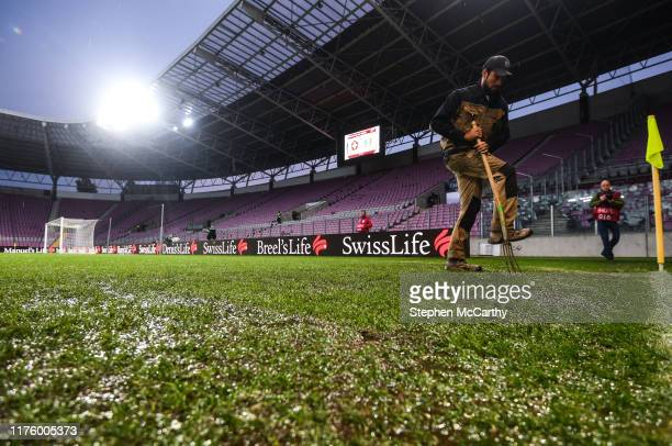 Geneva Switzerland 15 October 2019 A groundsman works on the pitch prior to the UEFA EURO 2020 Qualifier match between Switzerland and Republic of...
