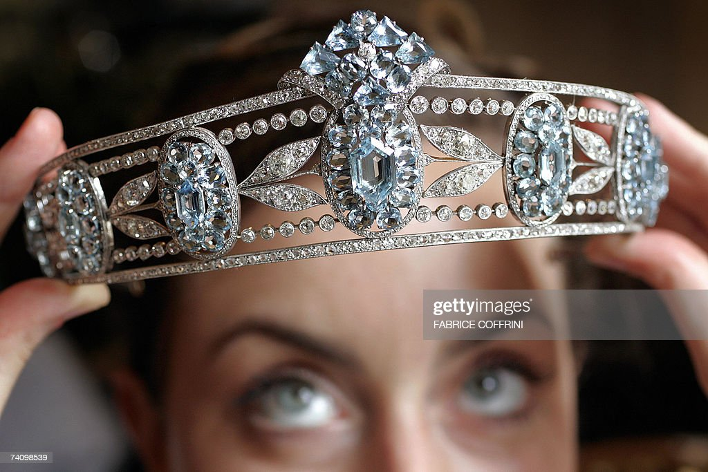 A model displays a tiara from Lady Hesketh's collection from circa 1910 and composed of a series of sky-blue oval aquamarines set among diamonds at a preview 08 May 2007 in Geneva. The tiara is expected to fetch 75,000 to 125,000 Swiss francs (USD 60,000 to 100,000) at a Sotheby's auction next 17 May.