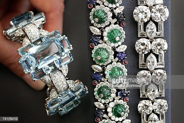 Rare aquamarine and diamond blangle, circa 1935 by Cartier, expected to fetch Euro 25,000-37 a gem-set bracelet with emeralds, diamonds, sapphires...