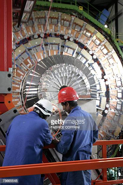 An engineer works to assemble 22 Mars 2007 near Geneva one of the layers of the world's largest superconducting solenoid magnet one of the...